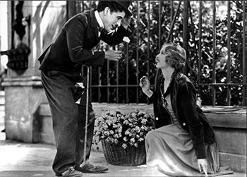 Chaplin con la violetera